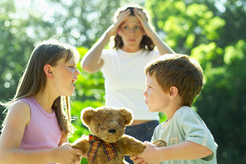 boy and a girl fighting over a teddy bear while mother holds her head in frustration